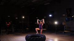 Fitness Model Posing With Chains and Tire - stock footage