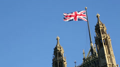 British flag on Palace of Westminster, London, UK Stock Footage