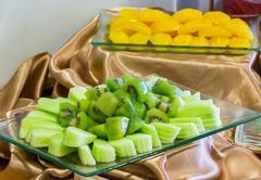 Kiwi and cantaloupe Stock Photos