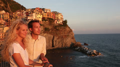 Couple in love by sunset in Cinque Terre - stock footage