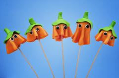 Cake pops with the shape of ghost halloween pumpkins Stock Photos