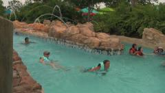 Random People Enjoying Lazy River at Water Park Stock Footage