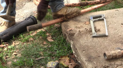 Plumber straiting a pipe Stock Footage