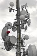 Communications tower for tv and mobile phone signals Stock Photos