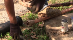 Plumber flaring a copper pipe Stock Footage