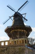 old wood and stone historical wind mill in europe - stock photo