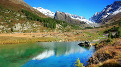 Beautiful mountain and lake under Alps Stock Footage