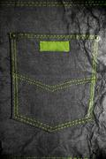 Crushed jean with a pocket and green stitch Stock Photos
