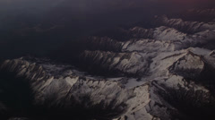 Snowy Alp mountains shot from a plane with 4k camera. Stock Footage