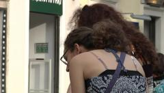 Street pet mercant attract two young woman. Stock Footage