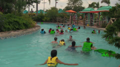 Unknown People Floating-by in Waterpark Lazy River - stock footage