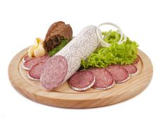 sliced sausage with bread, butter and vegetables - stock photo