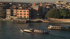 Venice dolly shot passing city bridge and boats, medium shot... Stock Footage