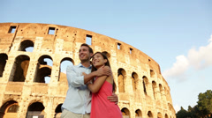 Happy couple on travel vacation, Coliseum, Rome Stock Footage