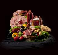 a composition of meat and vegetables with beer - stock photo