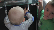Stock Video Footage of toddlers playing with old arcade