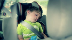 Boy sleeping in his car seat Stock Footage
