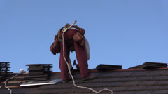 New Home Building boom, nailing roof tiles Stock Footage