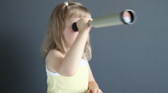 Charming little girl looking with terrestrial telescope Stock Footage