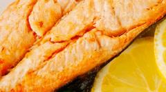 Grilled salmon steak on white Stock Footage