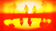 A squad of special forces soldiers returning from a mission at sunset. Stock Footage