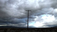 Time Lapse of Telephone Pole the Mojave Desert Storm Clouds -4K - stock footage
