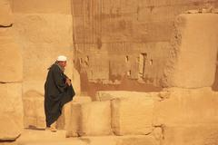 Stock Photo of local man standing at karnak temple complex, luxor