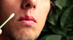herpes treatment over the lip with a special cream - stock footage