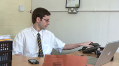 Businessman answers the phone Stock Footage
