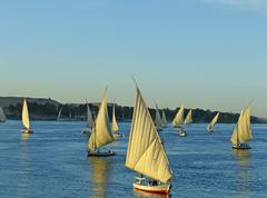 felucca boats sailing on the nile river, aswan - stock photo