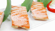 Stock Video Footage of grilled sea salmon chunks with pepper