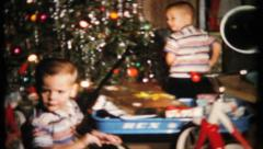 438 - boys get bikes & more on Christmas - vintage film home movie  Stock Footage