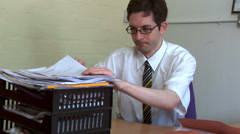 Businessman upset he can't find document Stock Footage