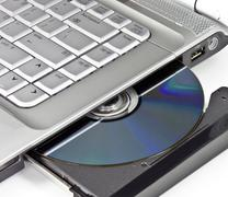 Optical Disc Ejected From A Laptop Stock Photos