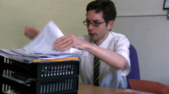 Businessman stressed he can't find document Stock Footage
