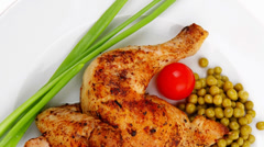 Chicken legs grilled and garnished Stock Footage