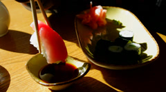 Sushi rolls. Dip sushi roll in the soy sauce. Stock Footage