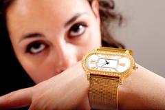clock and jewellery - stock photo