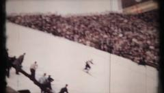Ski jumpers in competition at unknown location, 444 vintage film home movie Stock Footage