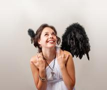 cute girl playing an angel - stock photo