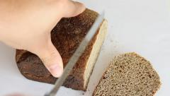 Sliced dark bread pieces, on white background Stock Footage