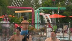 People at Water Park Kids Play Area with Water Features Stock Footage
