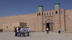 Tourists visit Khiva's Ichon Qala (walled city) in Uzbekistan, Silk Road Stock Footage