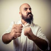 Angry fighter long beard and mustache man Stock Photos