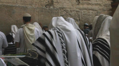Unidentified men in tefillin praying at the Wailing wall (Western wall) Stock Footage