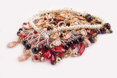 a pile of colored jewellery on white background - stock photo