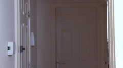 Female enters house drunk Stock Footage
