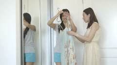 Asian Woman trying clothes Stock Footage
