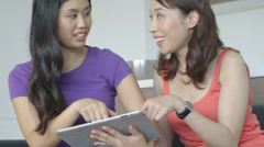 Asian Women friends using tablet and talking - stock footage