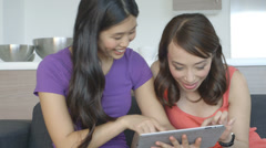 Asian Women using tablet and talking - stock footage